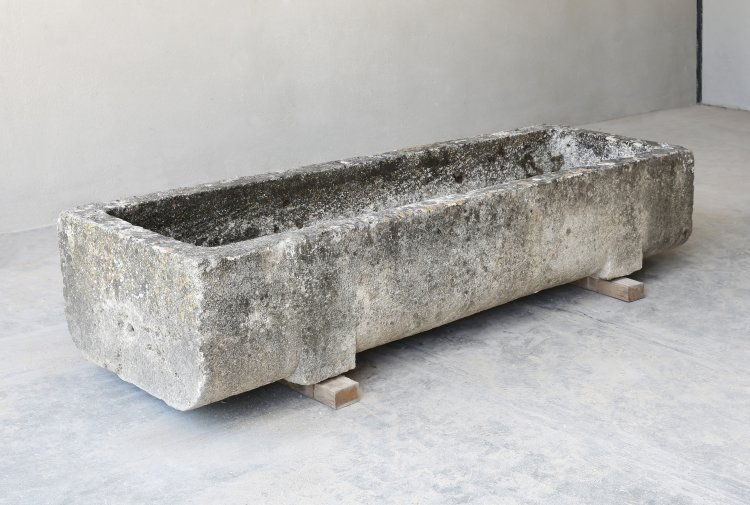 antique trough of french limestone