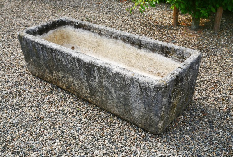 antique trough of natural stone