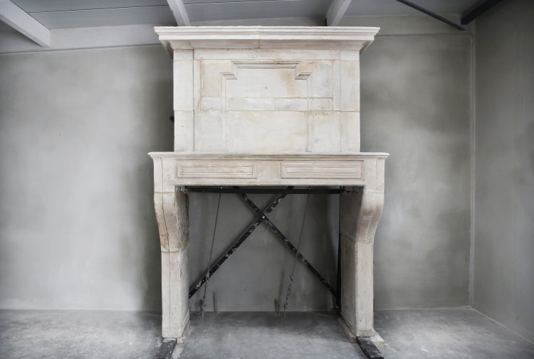 antique French fireplace of limestone