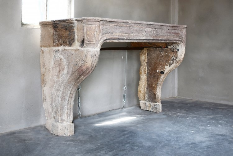 antique fireplace of french limestone