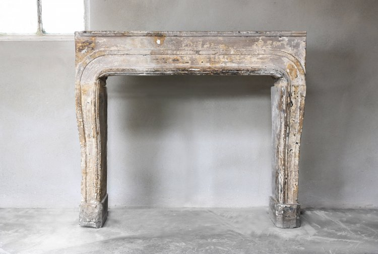 antique French limestone fireplace Louis XIV